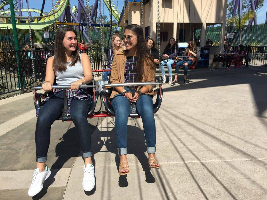 Seniors Alex Farrán and Victoria Oestermann sit on the swings during this year's Congé at Six Flags in Vallejo. Student body announced the day after Senior Presentations in a Wednesday assembly.