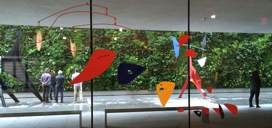 Double Gong, a 1953 mobile by Alexander Calder hangs in the Alexander Calder: Motion Lab exhbition at the San Francisco Museum of Modern Art. Calder is most famous for his hanging sculptures, which consist of abstract shapes connected by wires.