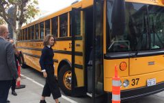 Senior Elisa Ternynck boards the bus to Cathedral of Saint Mary of the Assumption, the location of the annual Mass of the Holy Spirit. Bystanders outside of the church watched the Senior Class as they proceeded into the church last as per tradition.