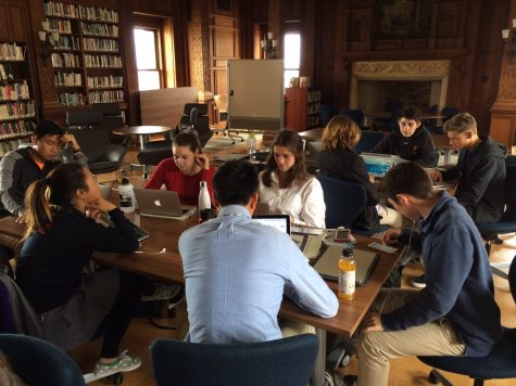 IB history students work to compile primary and secondary sources for a self produced