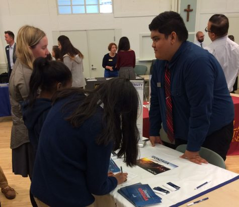 Seniors speak with an admissions representative from Gonzaga University in Spokane, Washington. The Jesuit Excellence Tour provided an opportunity for students to ask personal questions, fill out information cards, and pick up brochures and handouts from 20 schools.