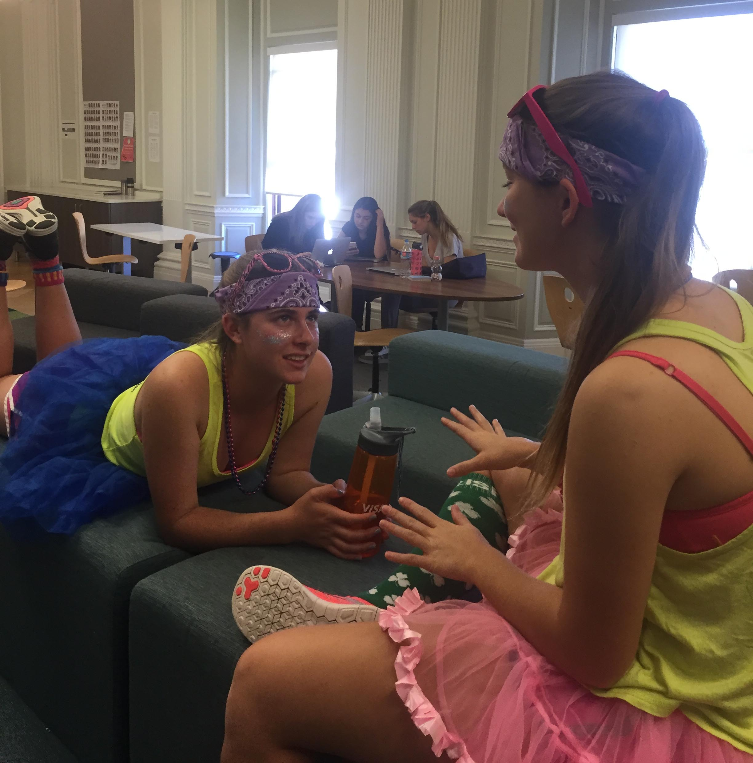 Seniors Katie Newbold and Delaney Moslander wear coordinating outfits for today's color day. The two handed out colorful bead necklaces to less eager participants.
