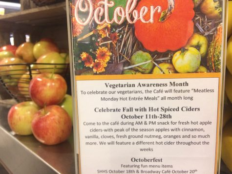 Flyers in cafeteria help promote Vegetarian Awareness Month. This year the chefs started Meatless Mondays as an act of awareness.