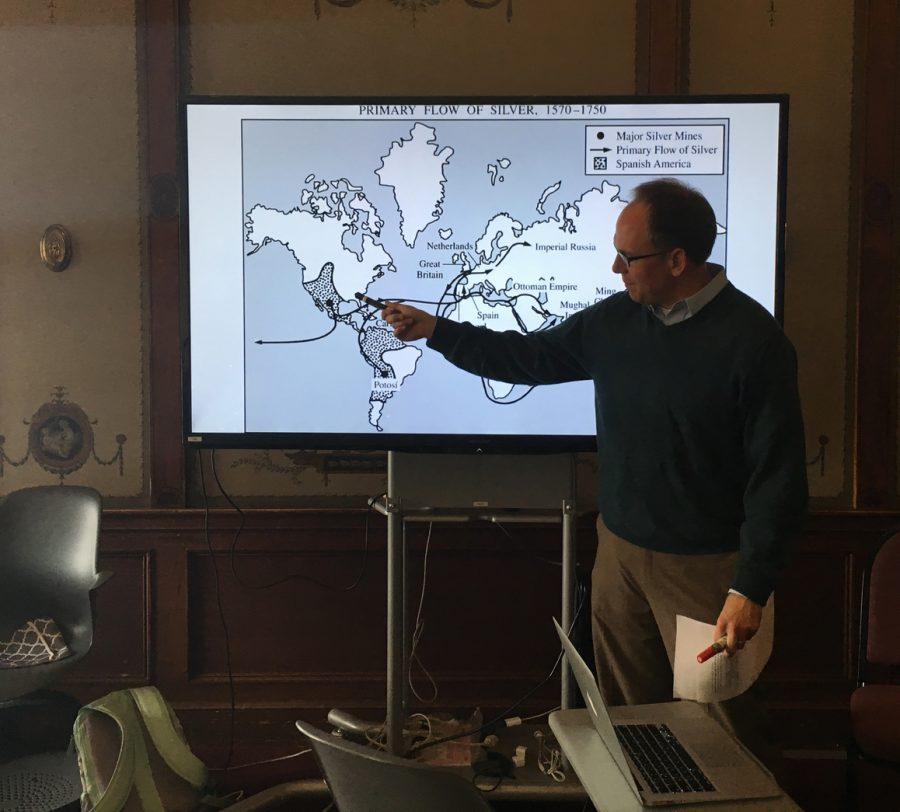 History teacher Michael Stafford further explains the effect of cultural imperialism through a world map. The discussion came after the class presented unit videos and celebrated with snacks.