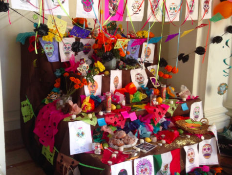 A Day of the Dead altar made by Convent Elementary students stands in the Main Hall commemorating those who have died. Others wrote down the names of those they would like to honor on a sticky note and placed it on the altar.