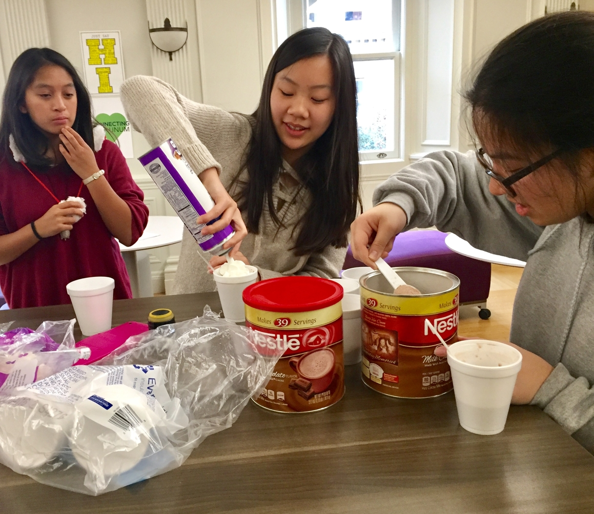 Sophomores prepare to sell hot chocolate during lunch in the Gallery. The sale raised money for the Service to the Homeless club, who will buy Christmas presents for some of San Francisco's homeless.