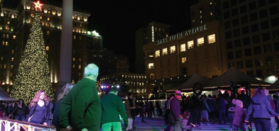 Attendees skate around the annual Ice Rink in Union Square. Holiday music is played throughout the day and color-changing neon lights illuminate the rink at night.