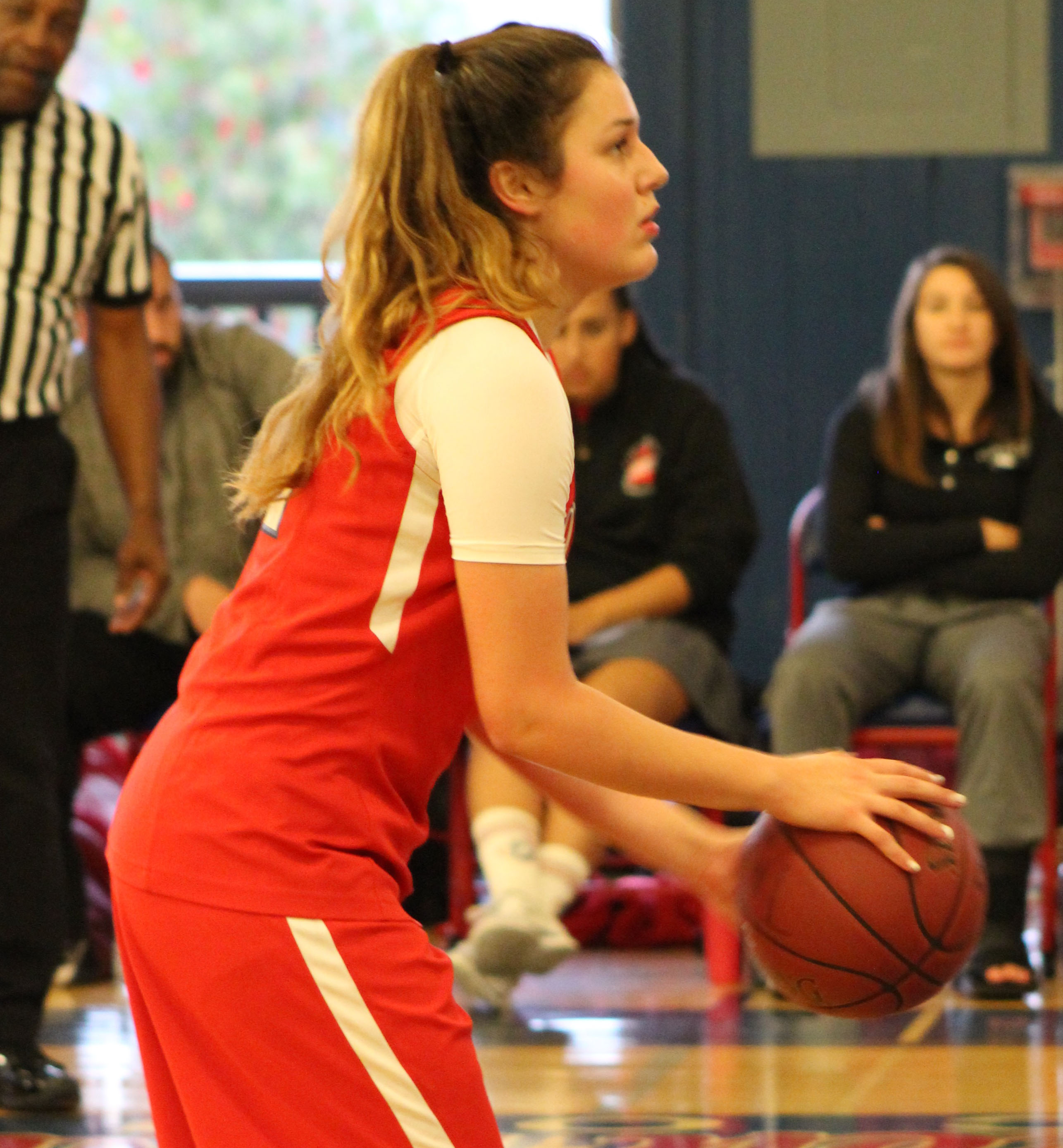 Senior Alyssa Alvarez prepares to take a free throw during a scrimmage against Mt. Tamalpais. Alvarez is a four-year varsity player and one of three senior captains. The team has already played in the Marin Academy Invitational Tournament and plans on playing in three more tournaments before the season starts.