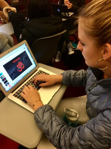 Sophomore Grace Boudreau reviews theology slides before her final presentation in class. Students were asked to give eight to ten minute summaries of an assigned passage, including any and all connections made to them.