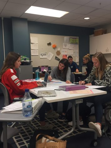 Juniors Mary Gray Simon, Rosie Morford, and Caroline O'Connell study in Mr. Person-Rennell's room during a free period. Students took advantage of the quiet space to get some work done.