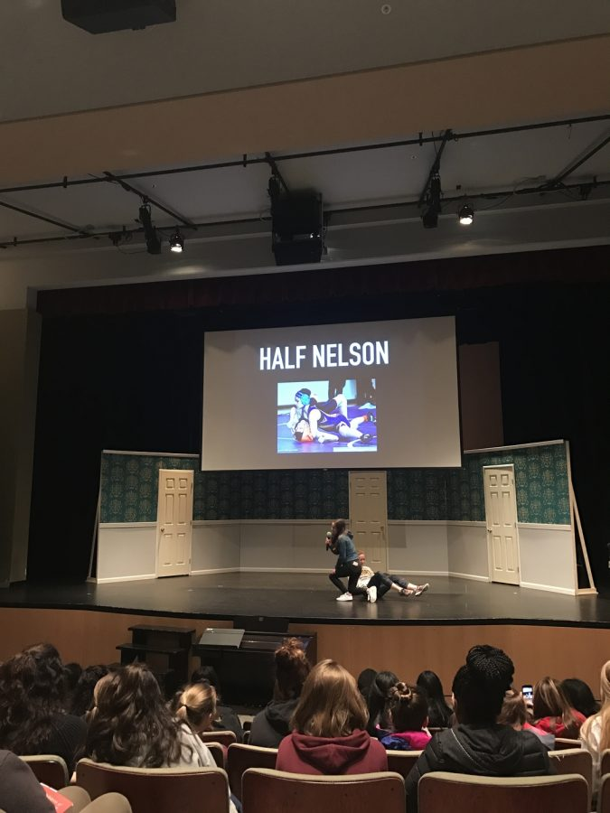 During the end of the week assembly seniors Masha Kozlova and Olivia Hoekendijk demonstrate a wrestling move to the school. Once a week during assembly, seniors do a presentation in front of the school describing something that interests them or something that makes them different.