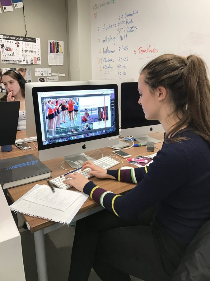 Junior Grace Lachman works on the tennis page in the yearbook after school to reach deadline. The 2016-2017 theme for yearbook is Amplifying Voices.