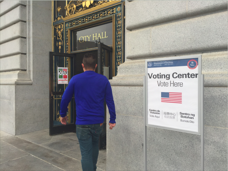 Early voters walk into San Francisco City Hall to cast ballots before election day on Nov. 8. Early voting began Oct. 24, and beginning Saturday, voters can cast ballots on weekends.