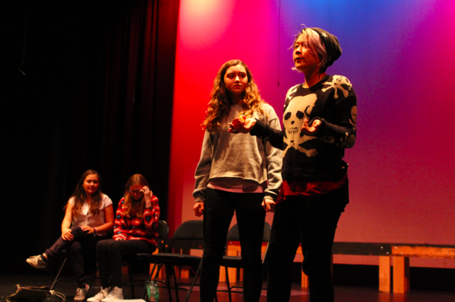 Sophomores Delaney Tobin and Darrean Loy act out a scene from Sixteen in 10 Minutes or Less. Incorporating some scenes from the actors themselves, the play tries to illustrate the daily life of a teen through a compilation of short plays.