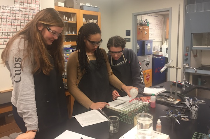 Seniors Dot Wetmore, Gia Monachino and Ana Cahaus work on an AP Chemistry lab that was postponed until today because of Siboni's closure. The chemistry class, along with most math and science classes, was relocated to Stuart Hall.