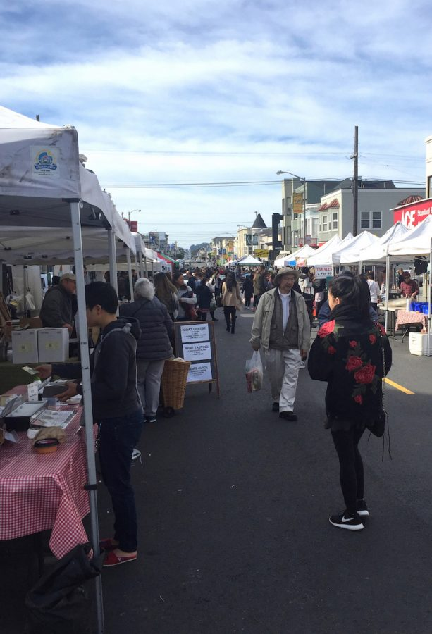 Shoppers walk up and down the two-block farmers market on Clement Street on a Sunday at noon. Pets are not allowed at farmers markets per health department regulations.