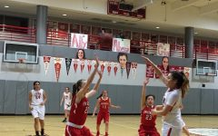Senior Alyssa Alvarez makes a shot while fellow teammates watch from the bench during the Varsity Senior Night game against University. This story was updated with a photo from the February 7 game.