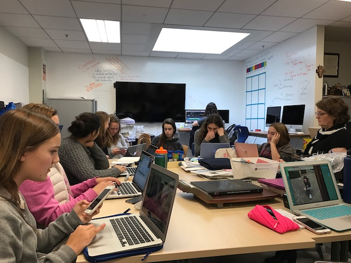 A Journalism 1 class practices the rule of thirds, a basic principle of news photography. The class took action shots around campus before returning to the Publications Lab to share with the group.