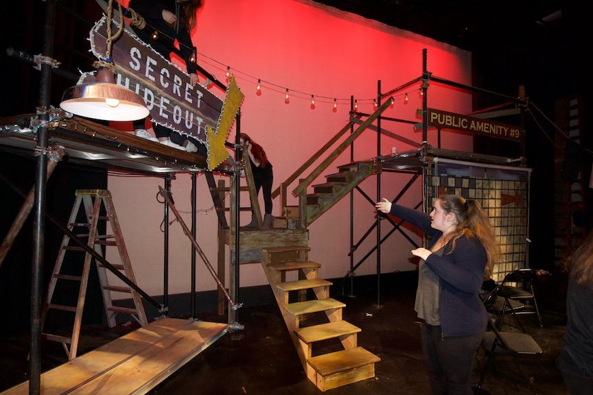 Stage manager Maya Shur helps to switch sets during intermission. The tech crew has to hurry between scenes and acts to rotate the props to set the stage for another location.