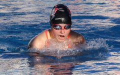 Anna Doggett swims the breaststroke in the March 2 pre-season swim meet. The swim team gained almost 20 new members this season.