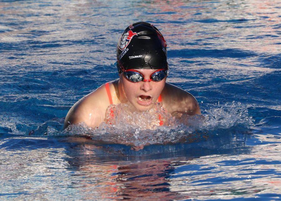 Anna Doggett swims the breaststroke in the March 2 pre-season swim meet. The swim team gained almost 20 new members this season.