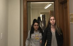 Two freshmen walk in front of the security camera in the second floor hallway. There are two other security cameras in the Main Hall and in the staircases.