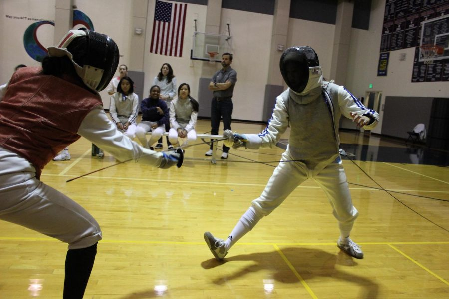 Fencing team captain April Matsumoto thrusts her foil at an opponent. Matsumoto is preparing the team for the San Francisco AAA/ CIF High School All-City Championship.
