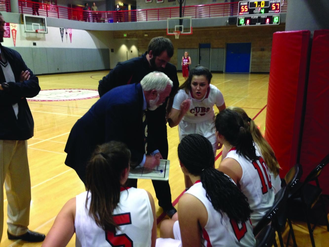 Captain Alyssa Alvarez offers advice to her basketball teammates during the first round of the North Coast Section championship bracket. The team had an undefeated league season but lost the first round of NCS to the Upper Lake Cougars, 56-58.