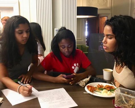 Jade Despanie and Malinalli Cervantes represent POCSU at the club fair in the Center on Tuesday as Avani Mankani signs up. POCSU was one of the 28 clubs represented at the fair.