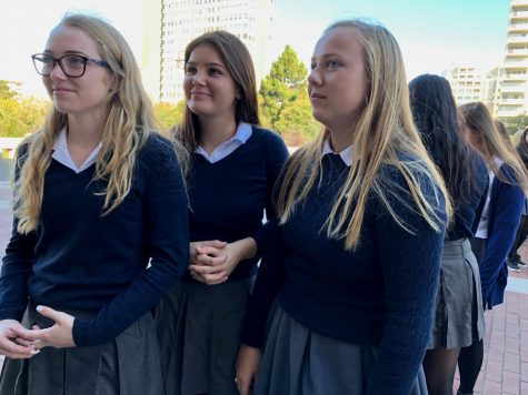 Seniors Annie Macken, Rosie Morford and Caroline O'Connell wait outside Saint Mary of the Assumption before the senior procession into the cathedral. The senior procession starts the Mass of the Holy Spirit along with the opening prayer.