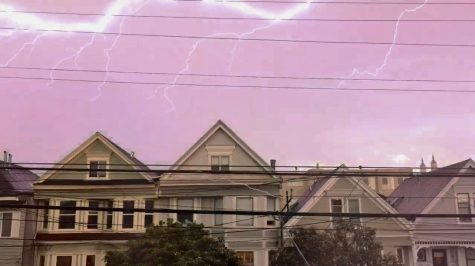 Lightning bolts flash across the San Francisco sky Monday evening in the Richmond district. Thunderstorms hit the Bay Area after high winds and abnormally warm weather.