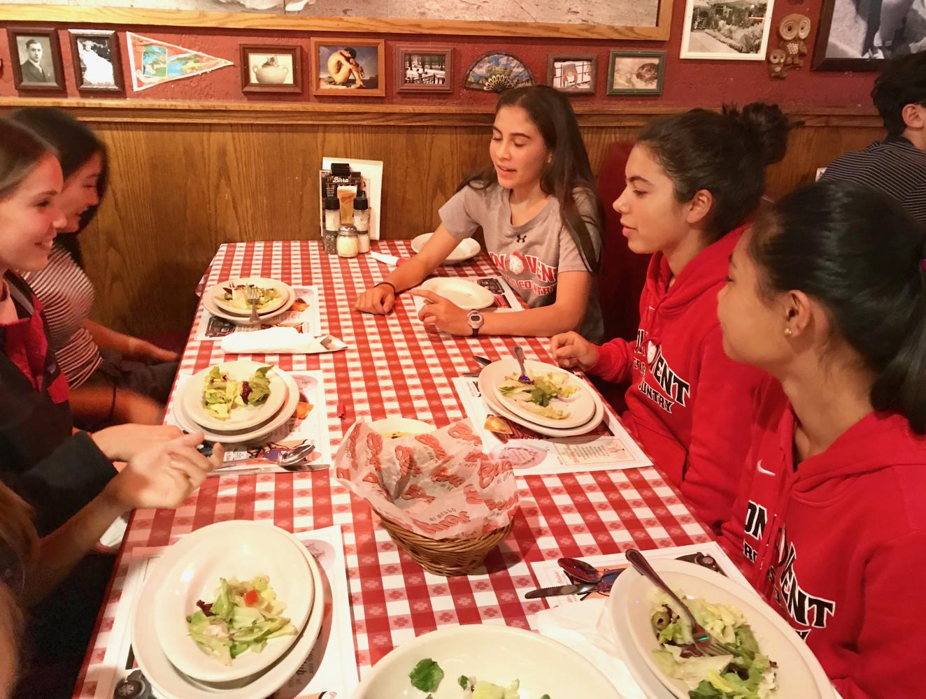 Freshmen part of the cross-country team eat dinner at Buca de Beppo in preparation for their race at the Mt. SAC Invitational tomorrow. Runners left school after F Period and bused to Los Angeles.