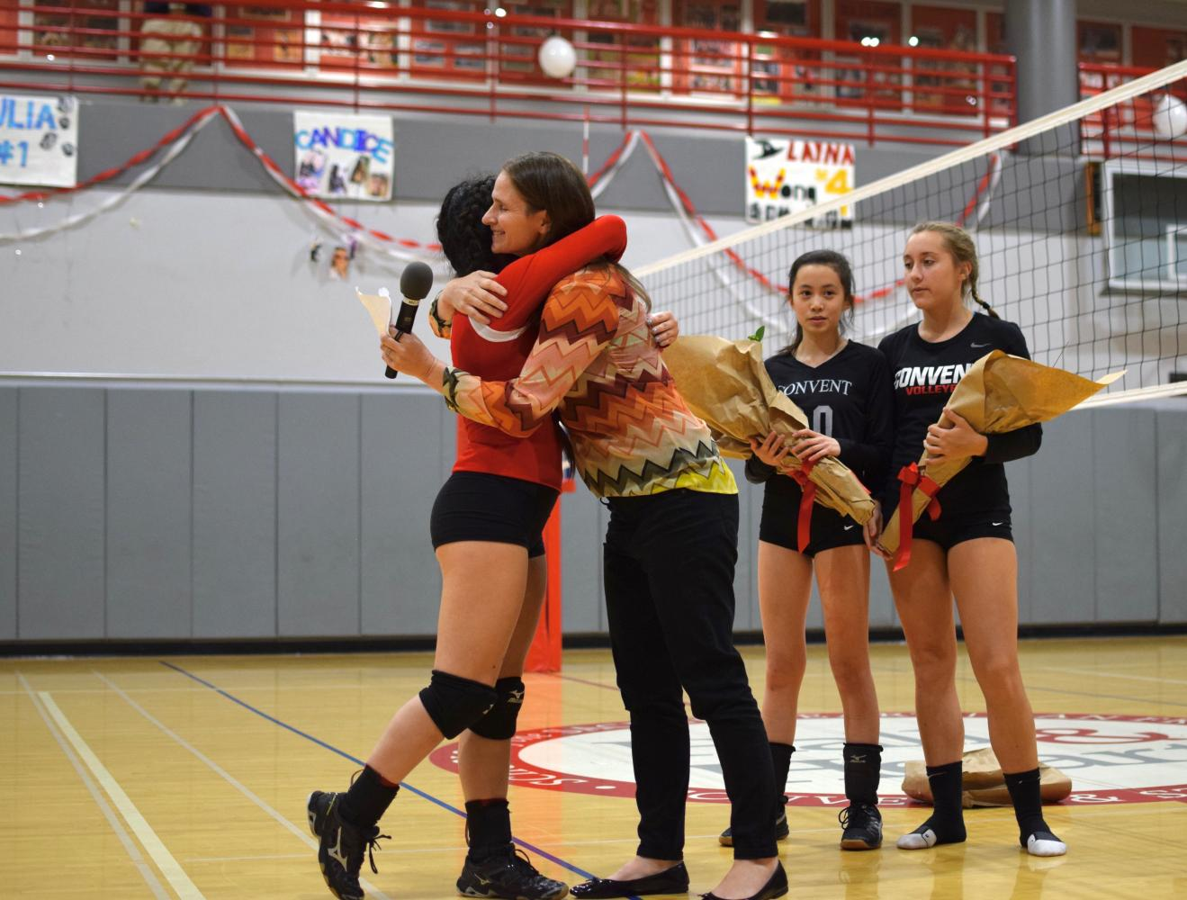 Senior Alayna Wong and Athletic Director Elena De Santis hug after Wong is called up as the first senior recognized of the night. De Santis honored each of the three seniors with short and personal speeches.