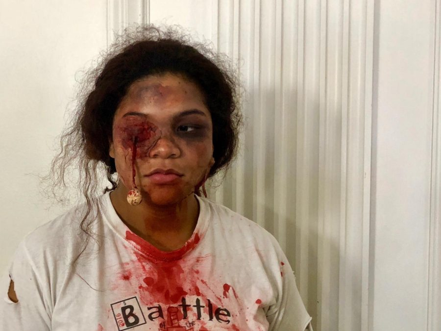 Sophomore Nyxa Aquino-Thomas dresses up as a zombie for the school Halloween celebration. Aquino-Thomas used makeup to create bruises, gashes and a fake eye popping out of its socket.