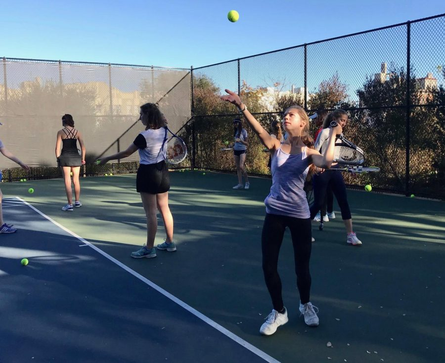 Sophomore Zoe Hinks serves during a JV tennis practice at Lafayette Park. The JV team has only two more practices up until the JV Jamboree, which will conclude their season.