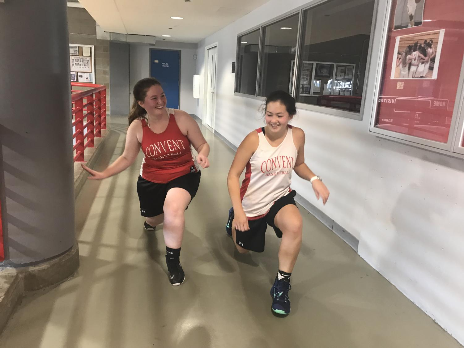 Senior Grace Ainslie and junior Mason Cooney cool down after a basketball open gym. This extra basketball practice was created in preparation for the upcoming basketball season.