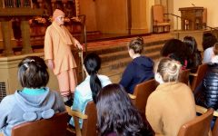 Swami Vendananda addresses sophomore students during their visit to the Vedanta Society as part of the Hinduism unit in their World Religions Text and Tradition Theology class. In addition to this trip, sophomores have read ancient Hindu texts and practiced yoga during this unit.