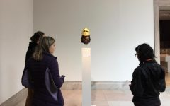 Sophomore Brooke Wilson listens to head set and looks at a replicated ancient sculpture during the Latin III Honors visit to the Legion of Honor Museum. Students had learned about polychromy and the science behind the colors prior to the trip.