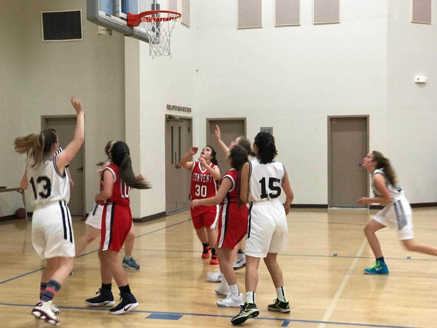 The JV basketball team defends Waldorf during the second quarter of the game. The quarter ended with Cubs up 8-6, but the game ended with a Convent loss of 23-15.