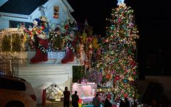 Crowds gather outside the home of Tom Taylor and Jerry Goldstein to see the grand Christmas display and visit Santa Claus. The couple hires Santa each night from 6:30-10:00 p.m. throughout December 24 to hand out candy canes and take photos.