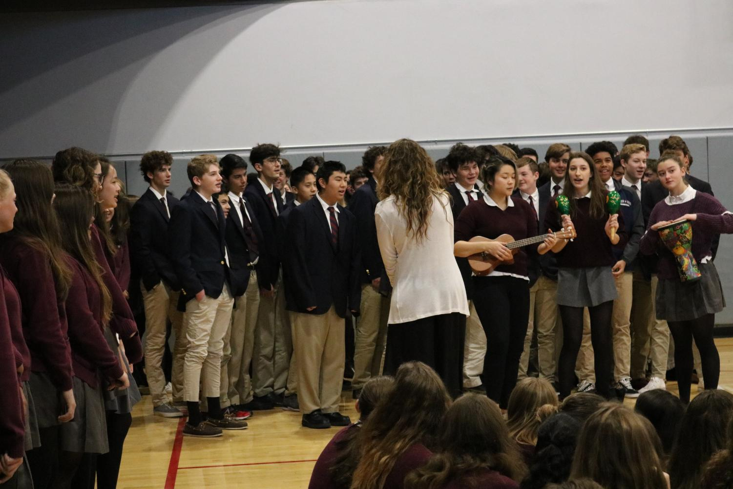Spanish teacher Mary Bicanic leads the high school Spanish classes in singing