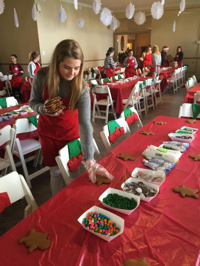 Junior Anna Doggett lays out gingerbread men to prepare for the Santa Fest holiday fundraiser at the General's Residence in Fort Mason. Children of Shelters runs the annual event in the Presidio for local homeless children.