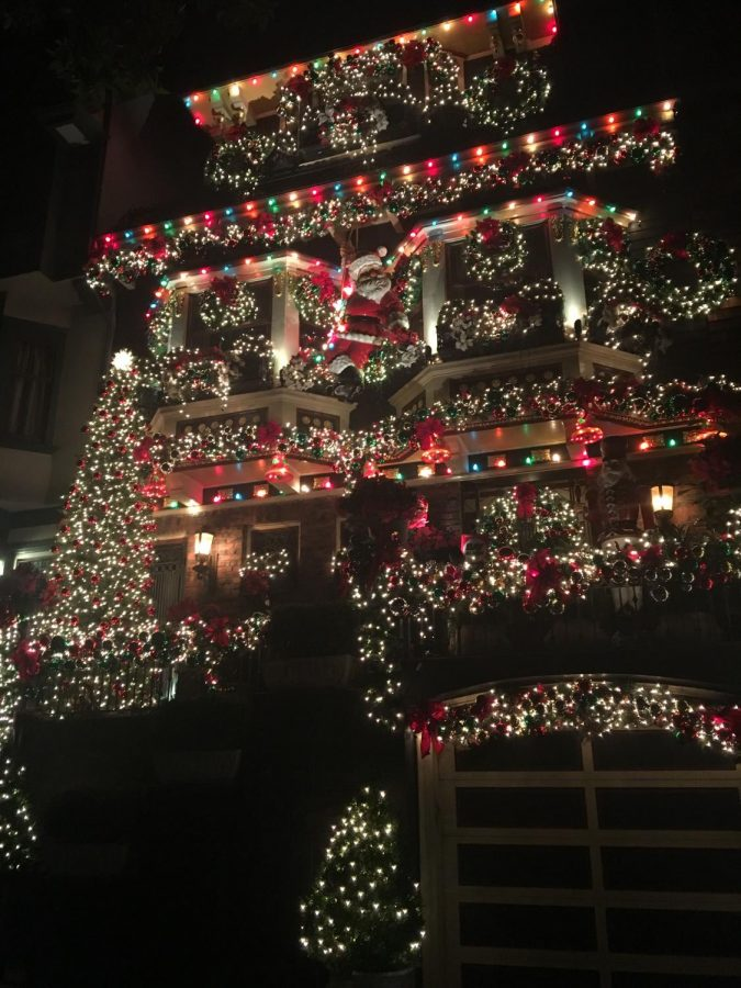 Castro St. resident Geoffrey Swenson decorates his three-story house with an assortment of lights, wreaths, and bows. Decorations go up each year the day after Thanksgiving.