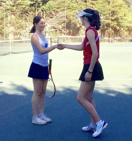 Team co-captain Josephine Rozzelle shakes hands with her opponent from the Urban School. Before each match, the captains from both teams announce each player who shakes the opposing teams hands as well as the hands of both coaches.