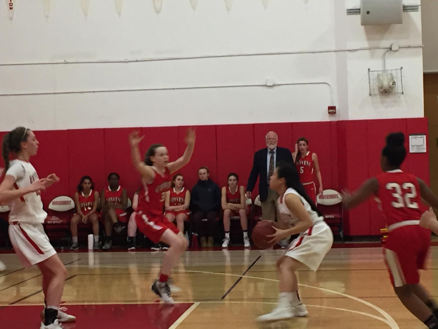 Sophomore Cece Mcquaid raises her arms as she tries to block a ball pass. The team played today's game at San Francisco University High School before a home game this Friday.