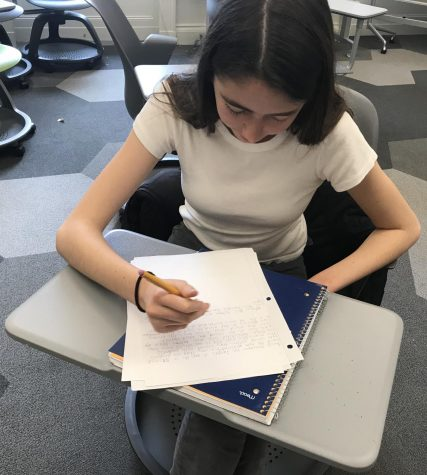 "Sophomore Isabella Parmenter hand writes a narrative during the formerly known Kate Chopin Writing Contest. Students were given their entire English periods to respond to the prompt ""when everything changed""."