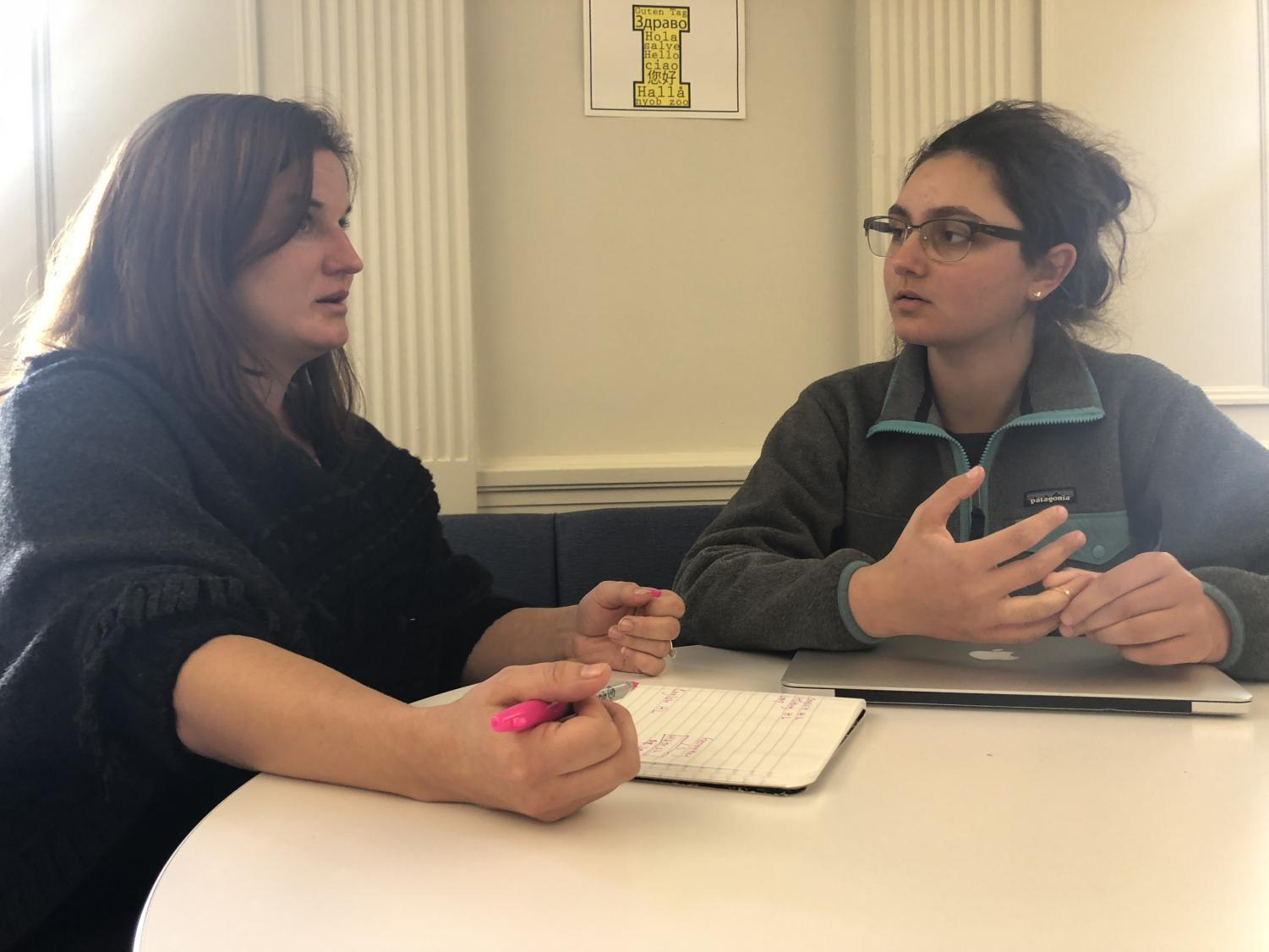 Sophomore Sonia Alazraie meets with Academic Director Betsy Pfeiffer to choose her classes for her junior year. Pfeiffer uses teacher recommendations and the student's interests to help choose the most beneficial classes for each student.