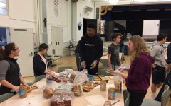 Freshmen Sarah El-Qadah, Gabrielle Gudio, Nigel Burris and Amy Phipps prepare sandwiches in the Columbus Room at Stuart Hall. One Less Hungry meets to pack lunches on Sundays once a month.