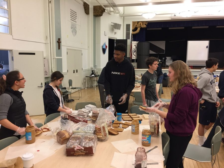 Freshmen+Sarah+El-Qadah%2C+Gabrielle+Gudio%2C+Nigel%0ABurris+and+Amy+Phipps+prepare+sandwiches+in+the+Columbus+Room%0Aat+Stuart+Hall.+One+Less+Hungry+meets+to+pack+lunches+on+Sundays%0Aonce+a+month.