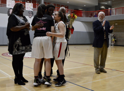 Junior Mason Cooney hugs senior Starr Hooper after Hooper was recognized in the Senior Night ceremony. Cooney and Hopper have been on varsity together for two years, and Monday was the final night that the two played on the same team.